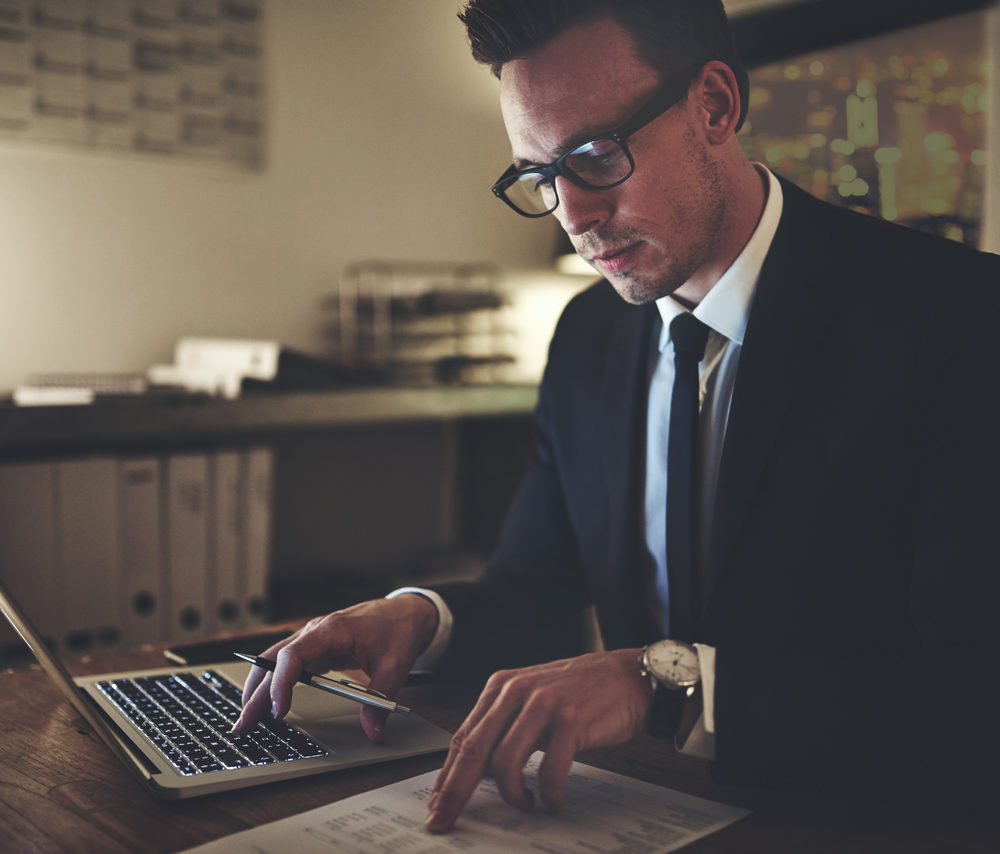 serious-business-man-working-on-documents-looking--KBJSXCA_Easy-Resize.com